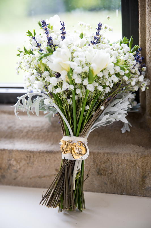 sligo wedding photographer brides bouquet in castle window