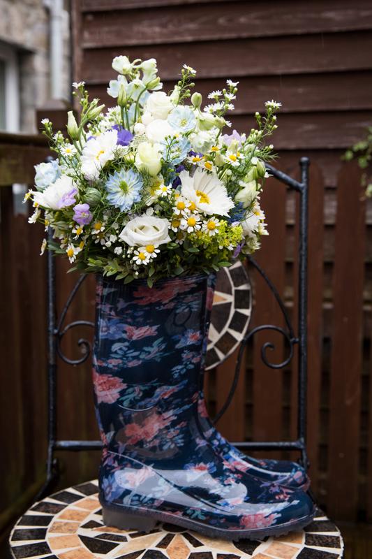 sligo wedding photographer brides bouquet inside her wellies