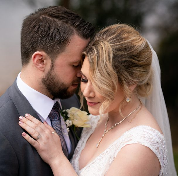 bride and groom tender wedding day embrace