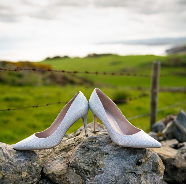 brides wedding shoes in the landscape photo
