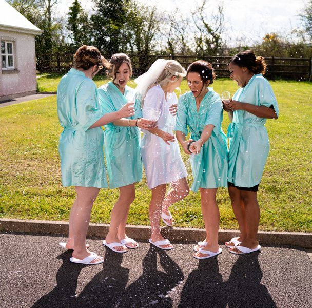 bridesmaids sprayed with champagne at donegal wedding