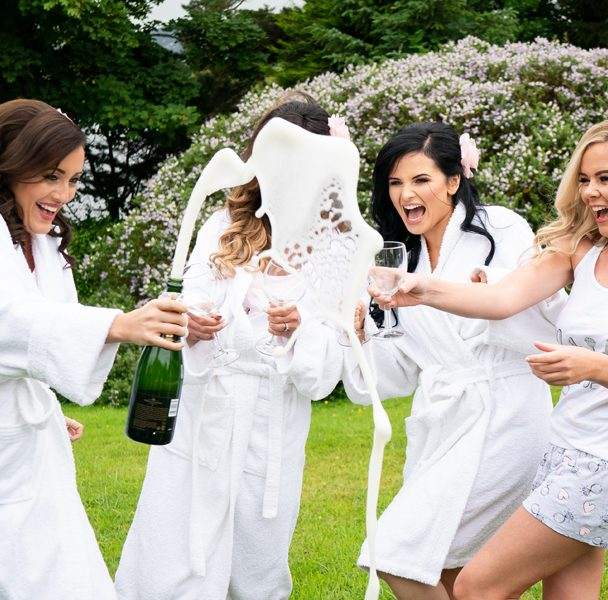 donegal wedding photographer bridesmaids open champagne