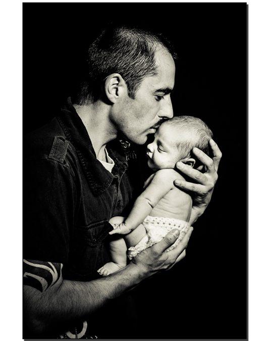 Loving Dad with his newborn son