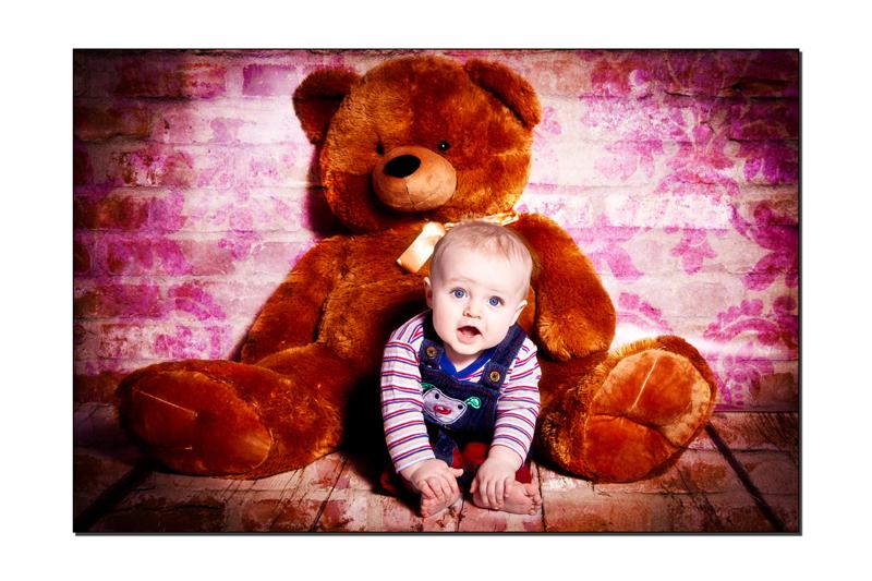 Baby boy with a large teddybear