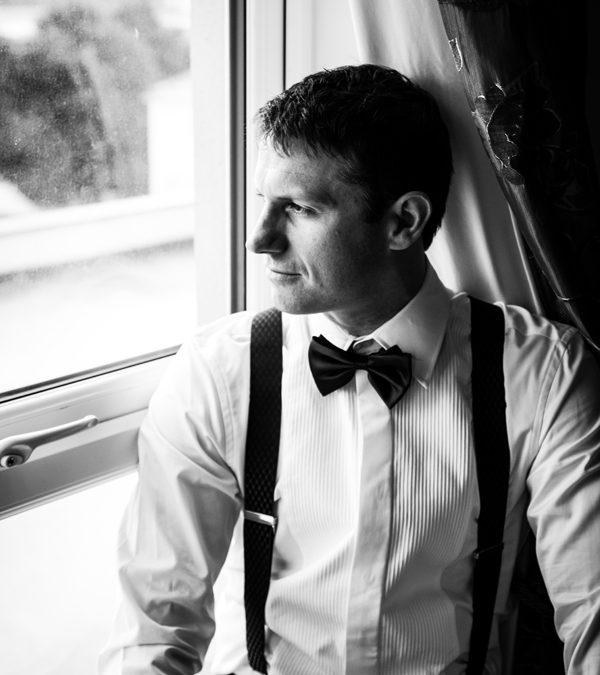 villa rose hotel groom portrait