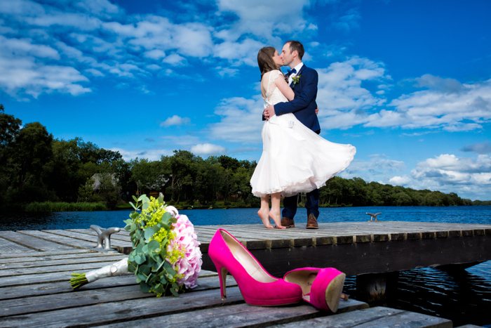 lusty beg wedding bride and groom on a wooden jetty