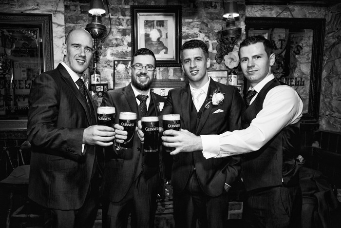 silver tassie hotel weddings groom and groomsmen enjoy a guinness