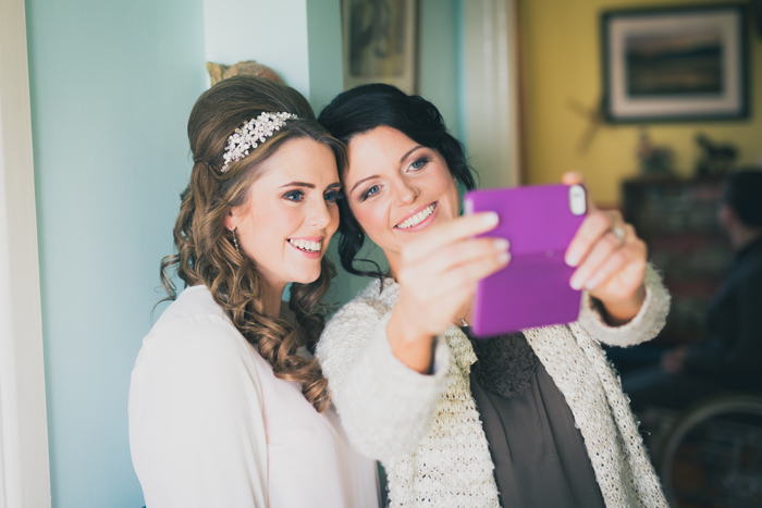 bride and bridesmaid taking a selfie