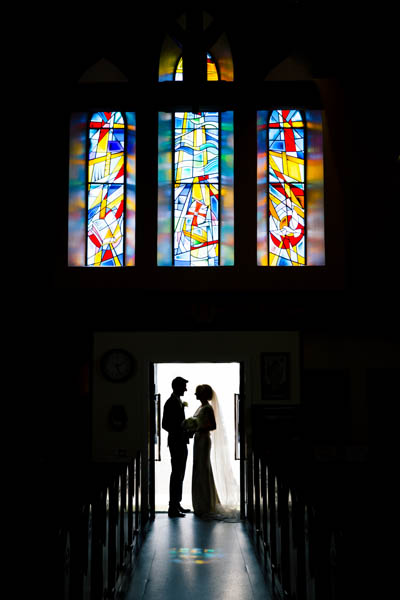 donegal and sligo wedding photography bride and groom in a church door