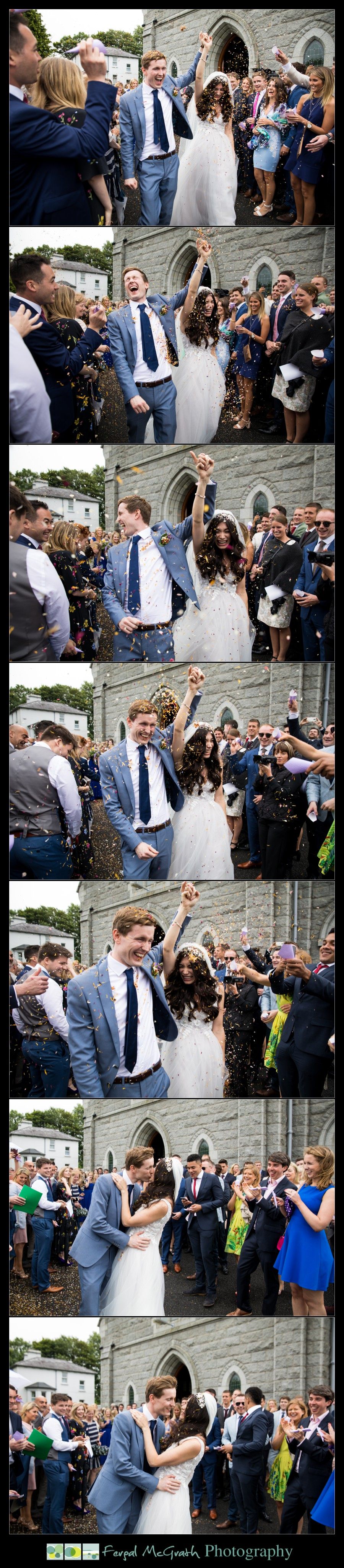 Markree Castle Wedding throwing confetti on the bride and groom