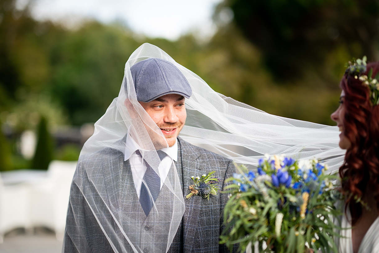 weddings in sligo in autumn groom photo with brides veil