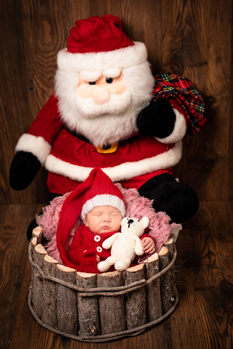 newborn photographers in donegal christmas photo of baby in a bucket in a santa suit