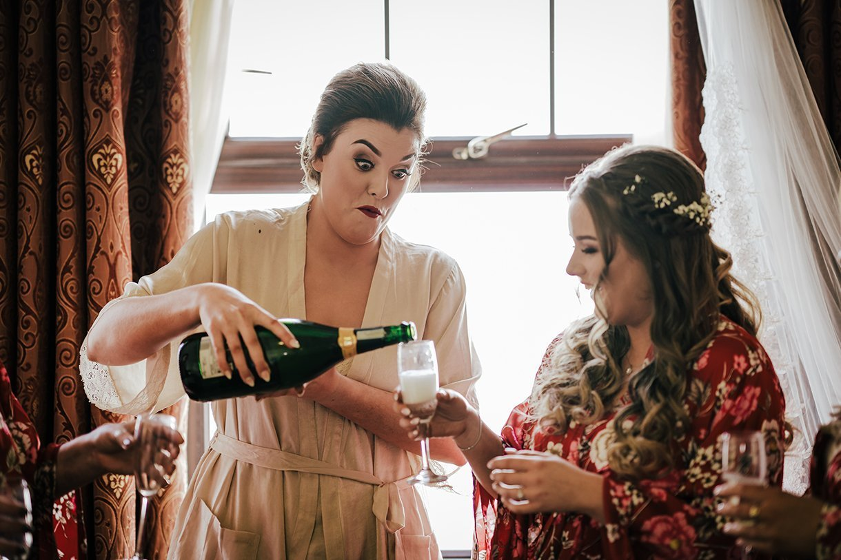 An Chuirt Hotel Gweedore Weddings bride pours champagne