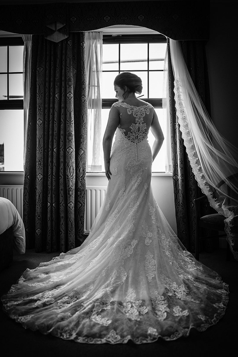An Chuirt Hotel Gweedore Weddings brides wedding dress from the back photo
