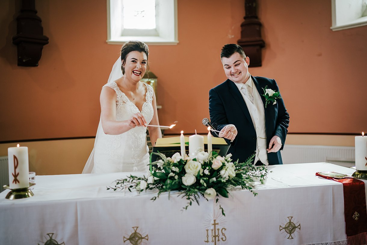 An Chuirt Hotel Gweedore Weddings couple lithe the candles