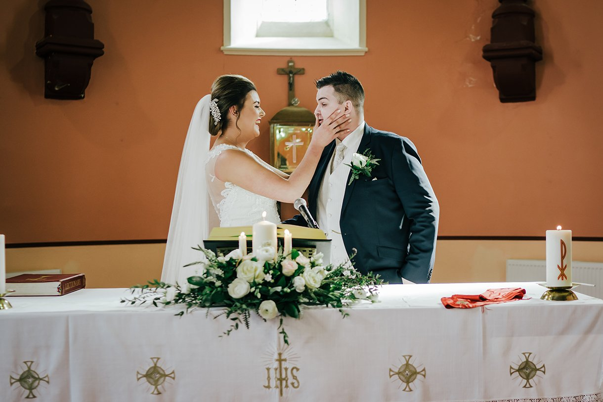 An Chuirt Hotel Gweedore Weddings bride wipes lipstick off the grooms face