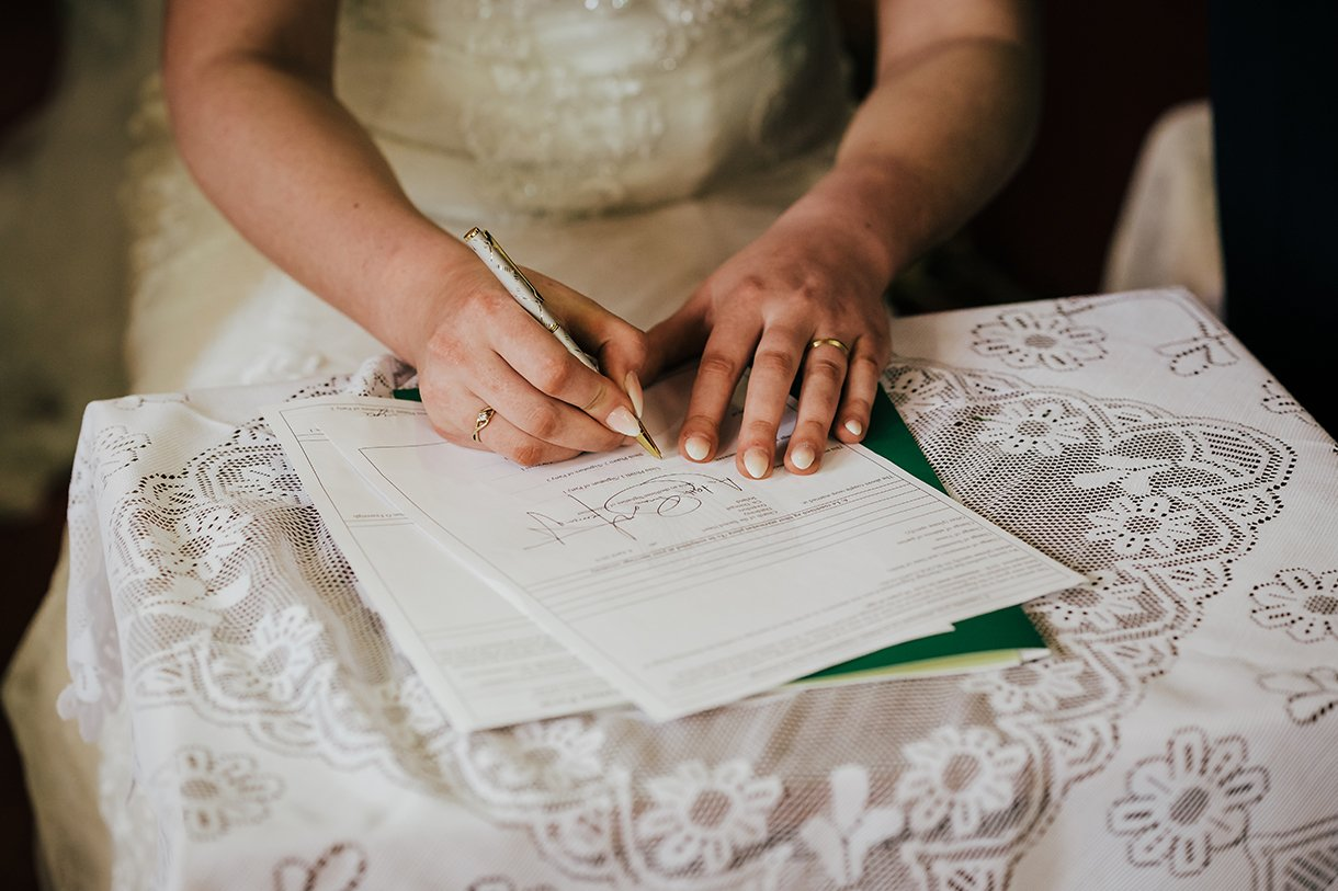 An Chuirt Hotel Gweedore Weddings bride signs the register