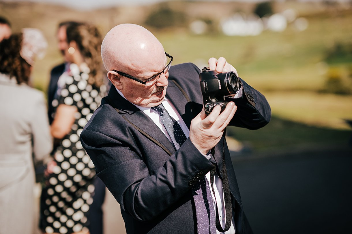 An Chuirt Hotel Gweedore Weddings guest with a camera