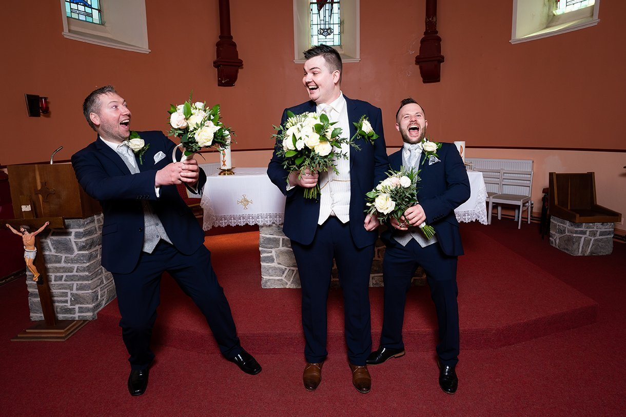 An Chuirt Hotel Gweedore Weddings groom and groomsmen mess with the flowers