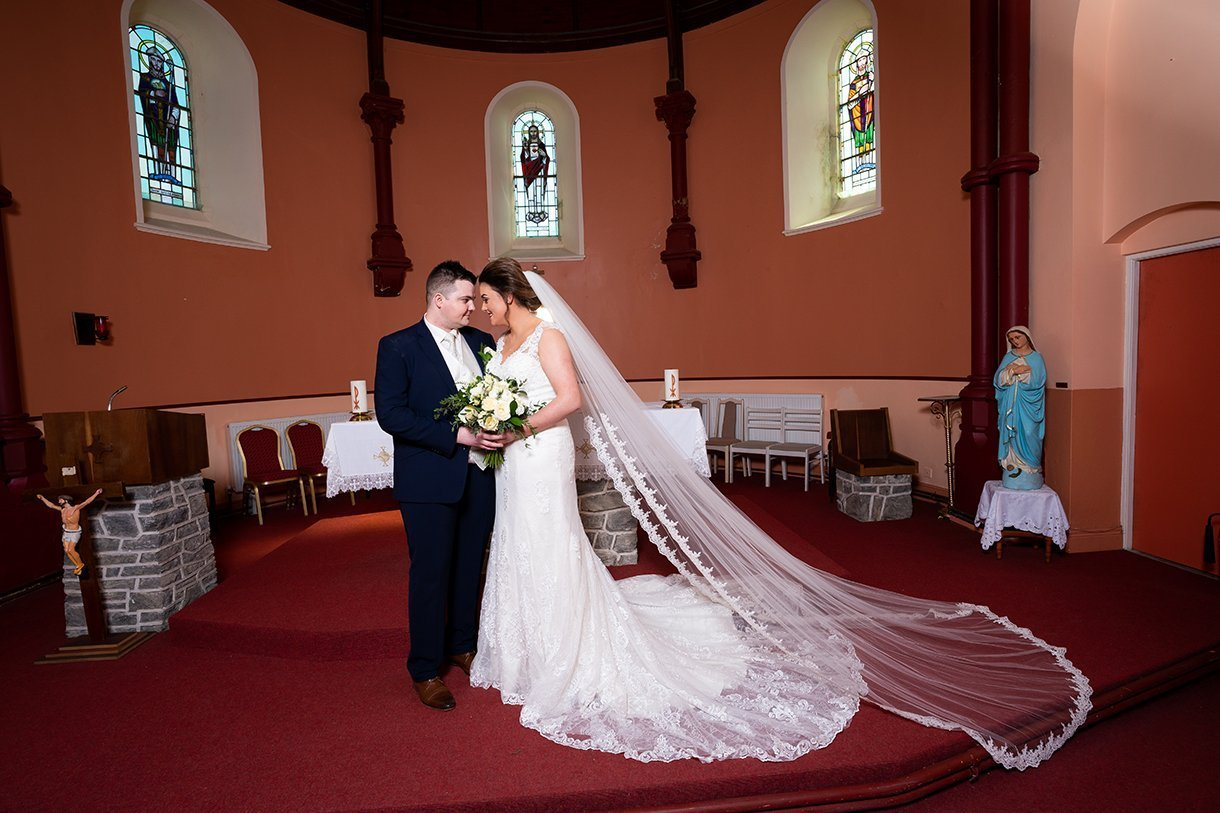 An Chuirt Hotel Gweedore Weddings bride and groom at the alter