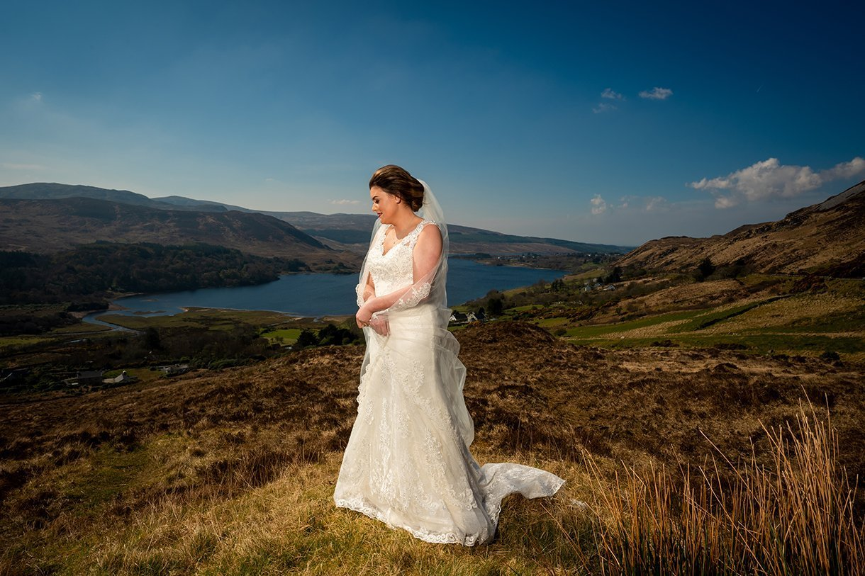 An Chuirt Hotel Gweedore Weddings bride portrait with lake behind her