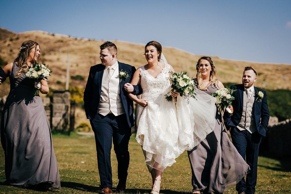 An Chuirt Hotel Gweedore Weddings walking and laughing bridal party