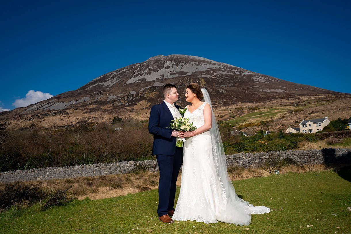 An Chuirt Hotel Gweedore Weddings bride and groom and errigal photo