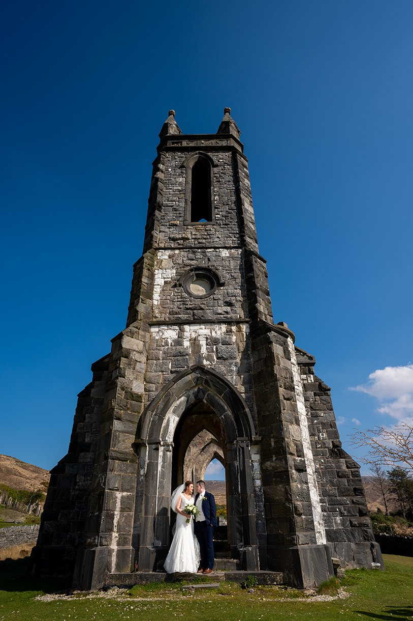 An Chuirt Hotel Gweedore Weddings bride and groom kiss at old church in dunlewey