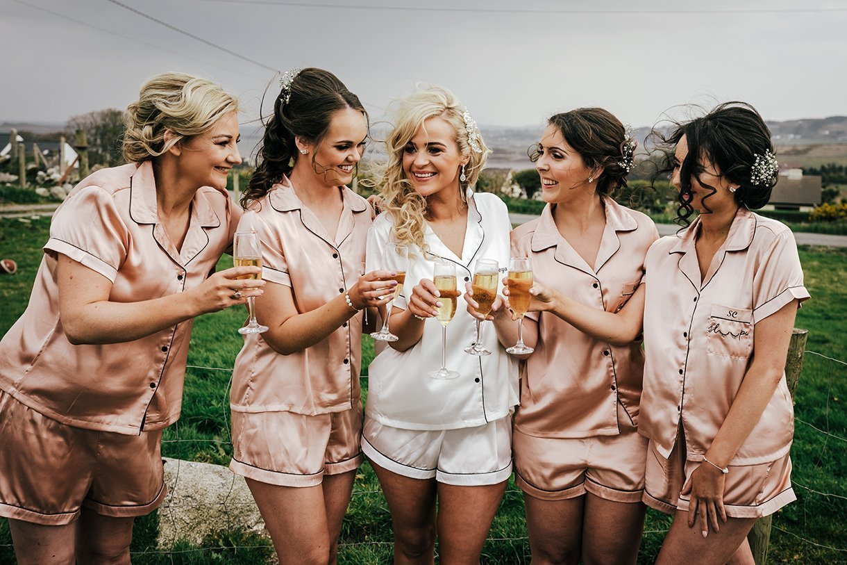 Waterfront Hotel Dungloe Wedding bride and bridesmaids have a glass of champagne
