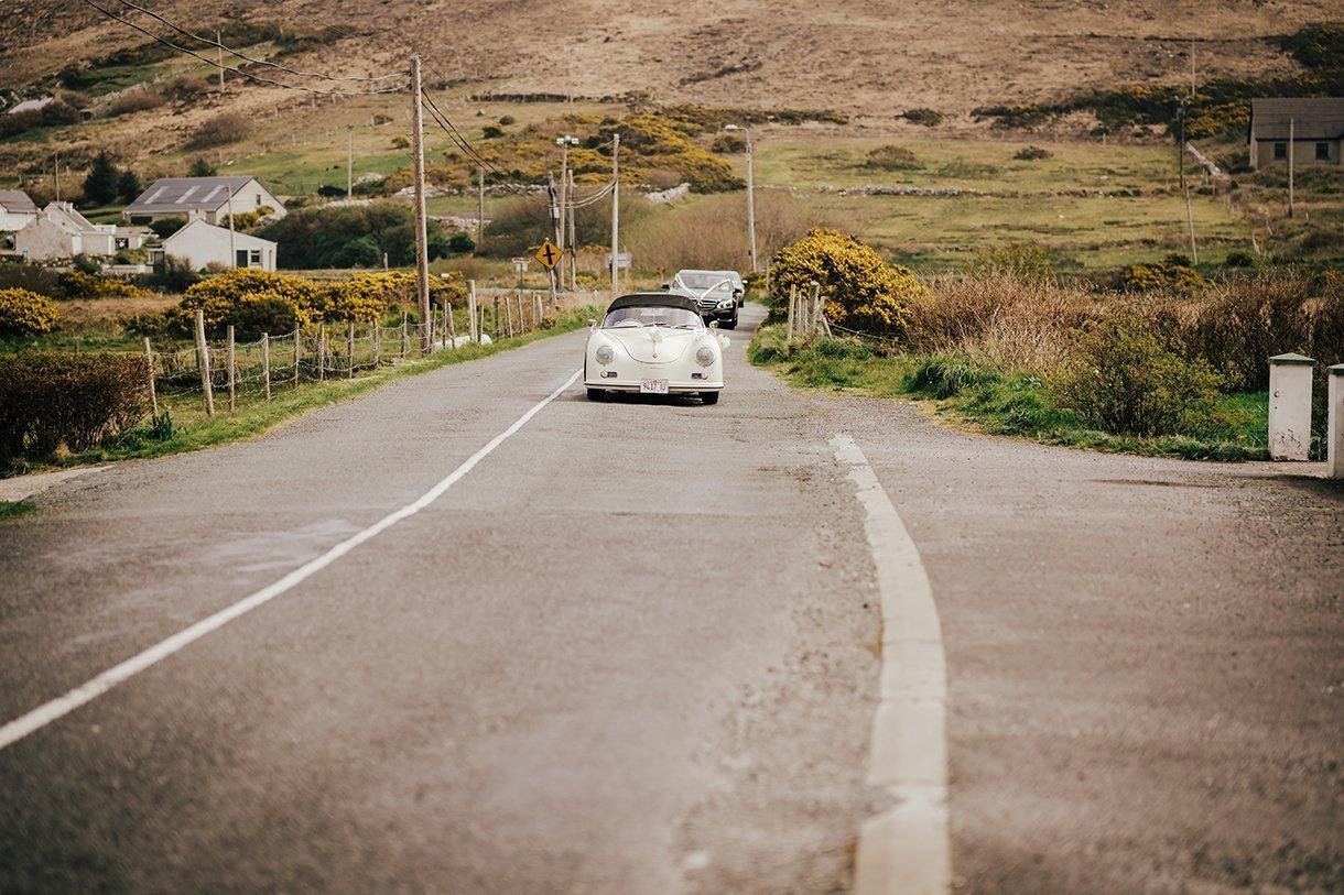 Waterfront Hotel Dungloe Wedding bride travelling in a vintage Porsche