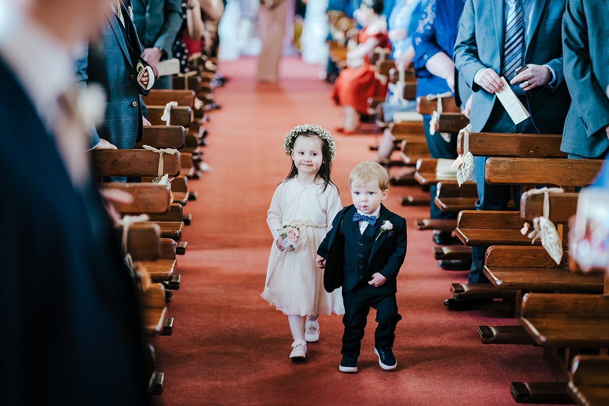 Waterfront Hotel Dungloe Wedding page boy and flower girl going up the aisle