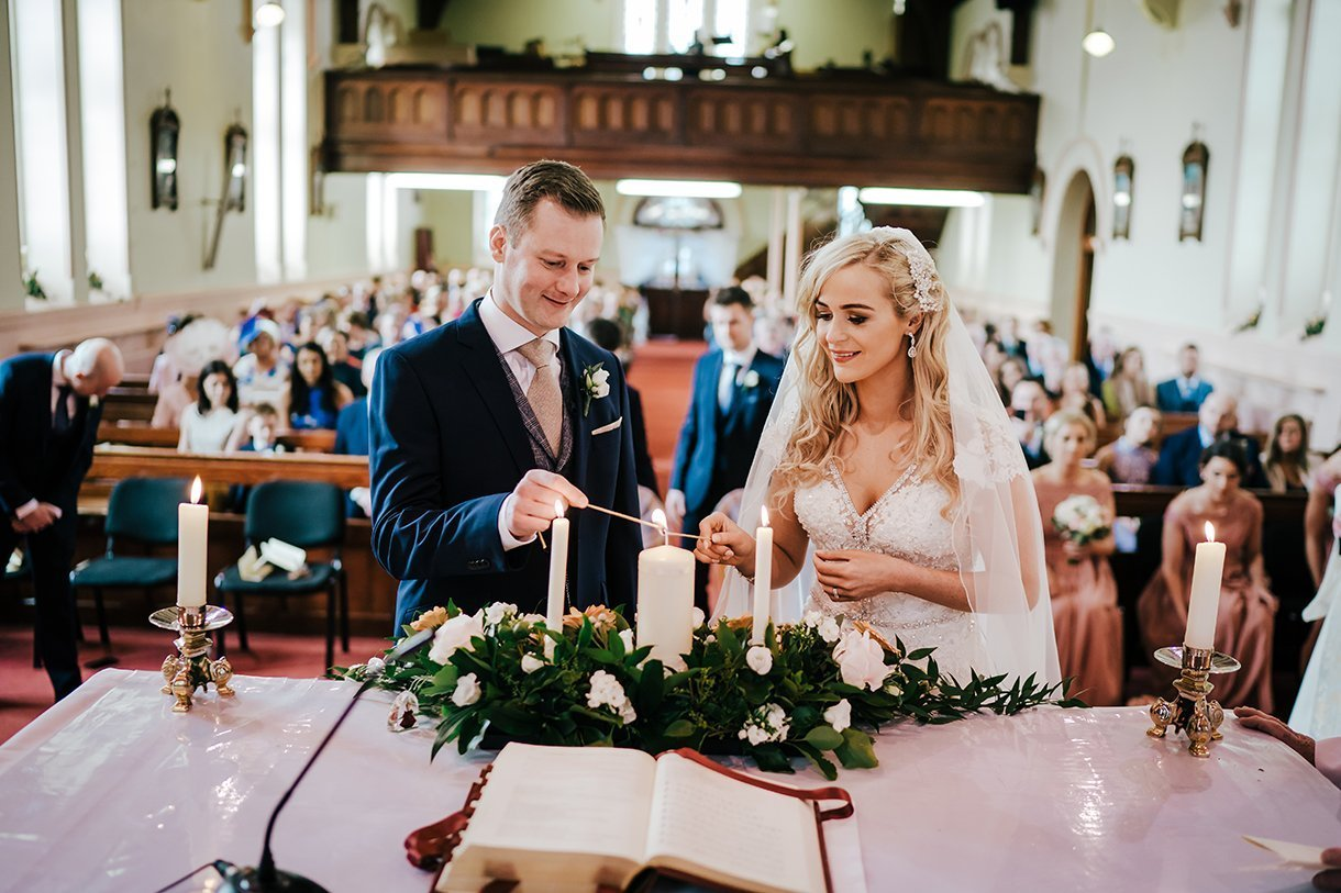 Waterfront Hotel Dungloe Wedding bride and groom light their candles