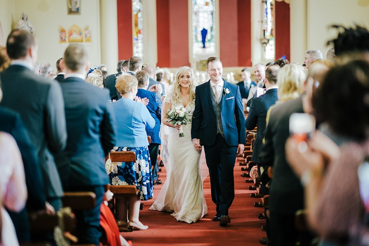 Waterfront Hotel Dungloe Wedding bride and groom leave the church