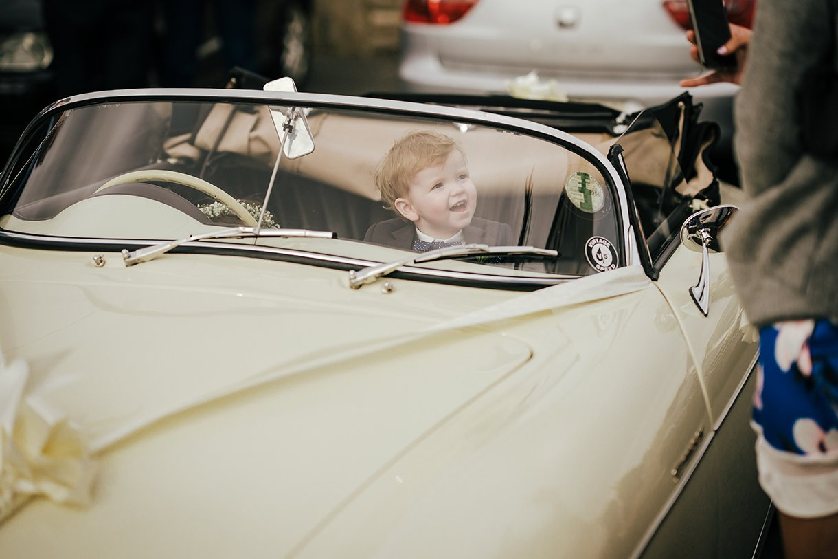 Waterfront Hotel Dungloe Wedding page boy in a porsche wedding car