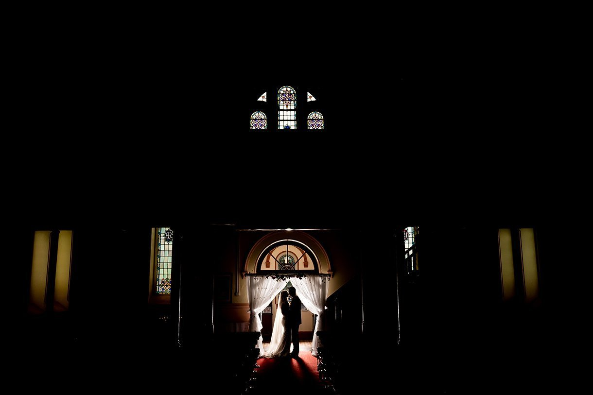 Waterfront Hotel Dungloe Wedding stunning silhouette photo of the bride and groom at the back of the church