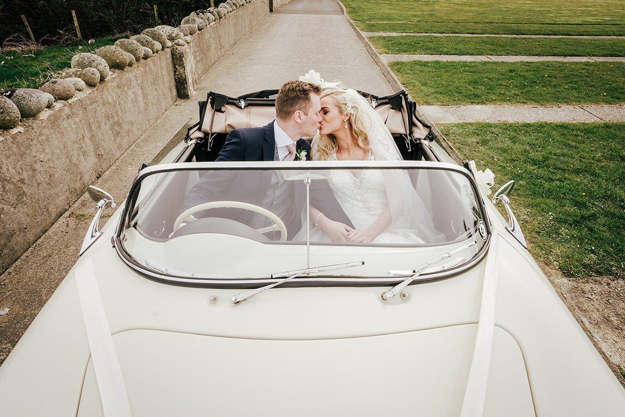 Waterfront Hotel Dungloe Wedding bride and groom in a Porsche wedding car