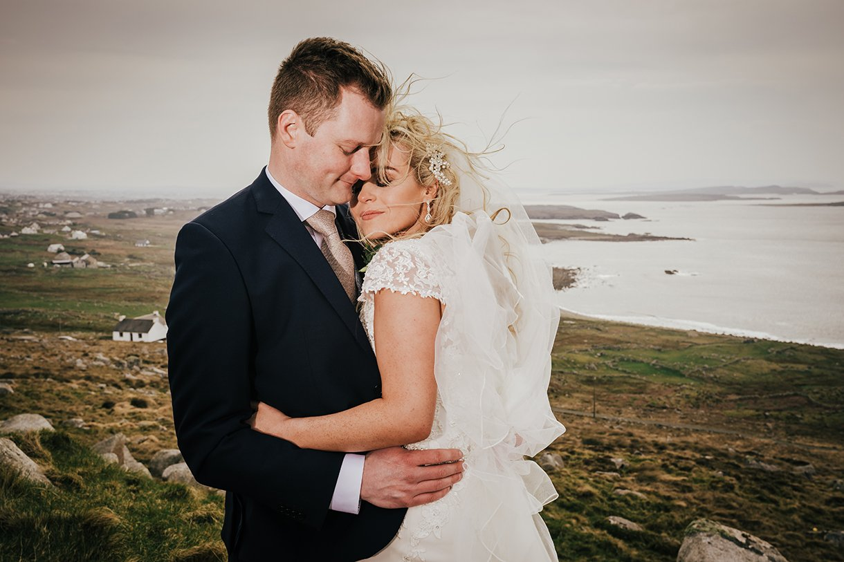 Waterfront Hotel Dungloe Wedding bride and groom snuggle in the wind
