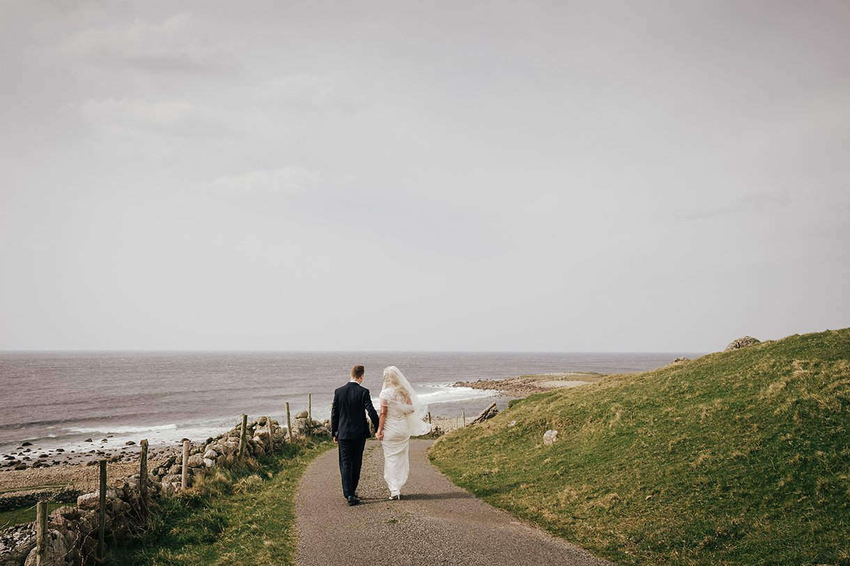 Waterfront Hotel Dungloe Wedding bride and groom go for a walk