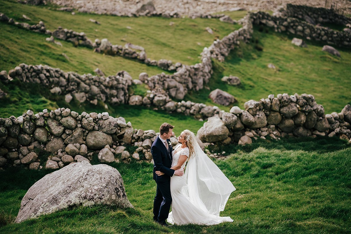 Waterfront Hotel Dungloe Wedding bride and groom photo among old stone walls at bloody foreland gweedore