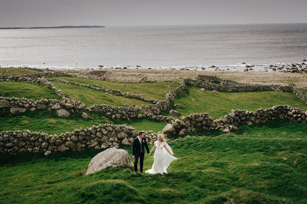 Waterfront Hotel Dungloe Wedding bride and groom in a field of old stone walls in gweedore co donegal