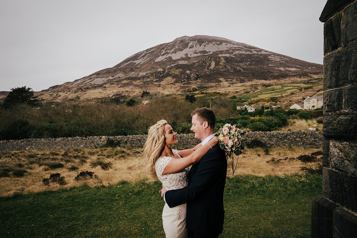 Waterfront Hotel Dungloe Wedding bride and groom with errigal in the background