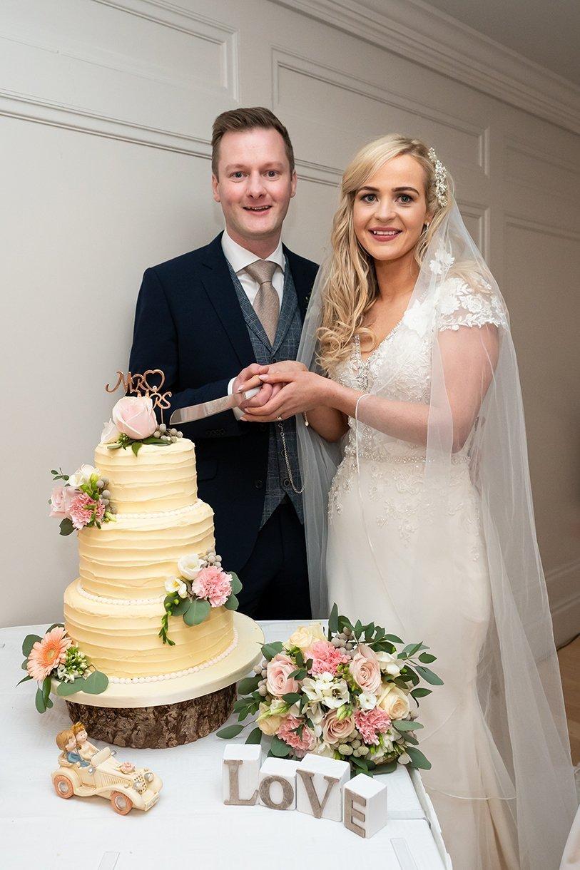 Waterfront Hotel Dungloe Wedding bride and groom cut their wedding cake