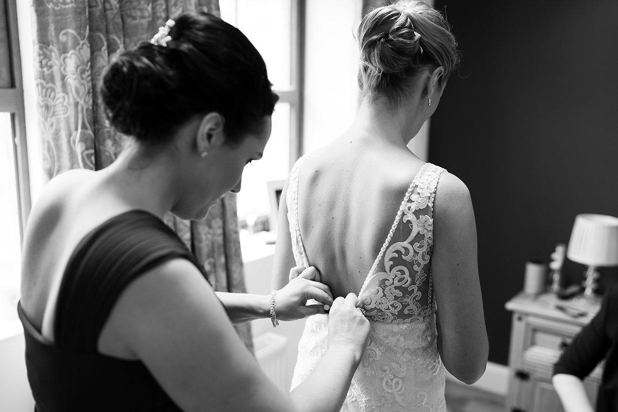 Allingham Hotel Bundoran Wedding bride getting wedding dress on