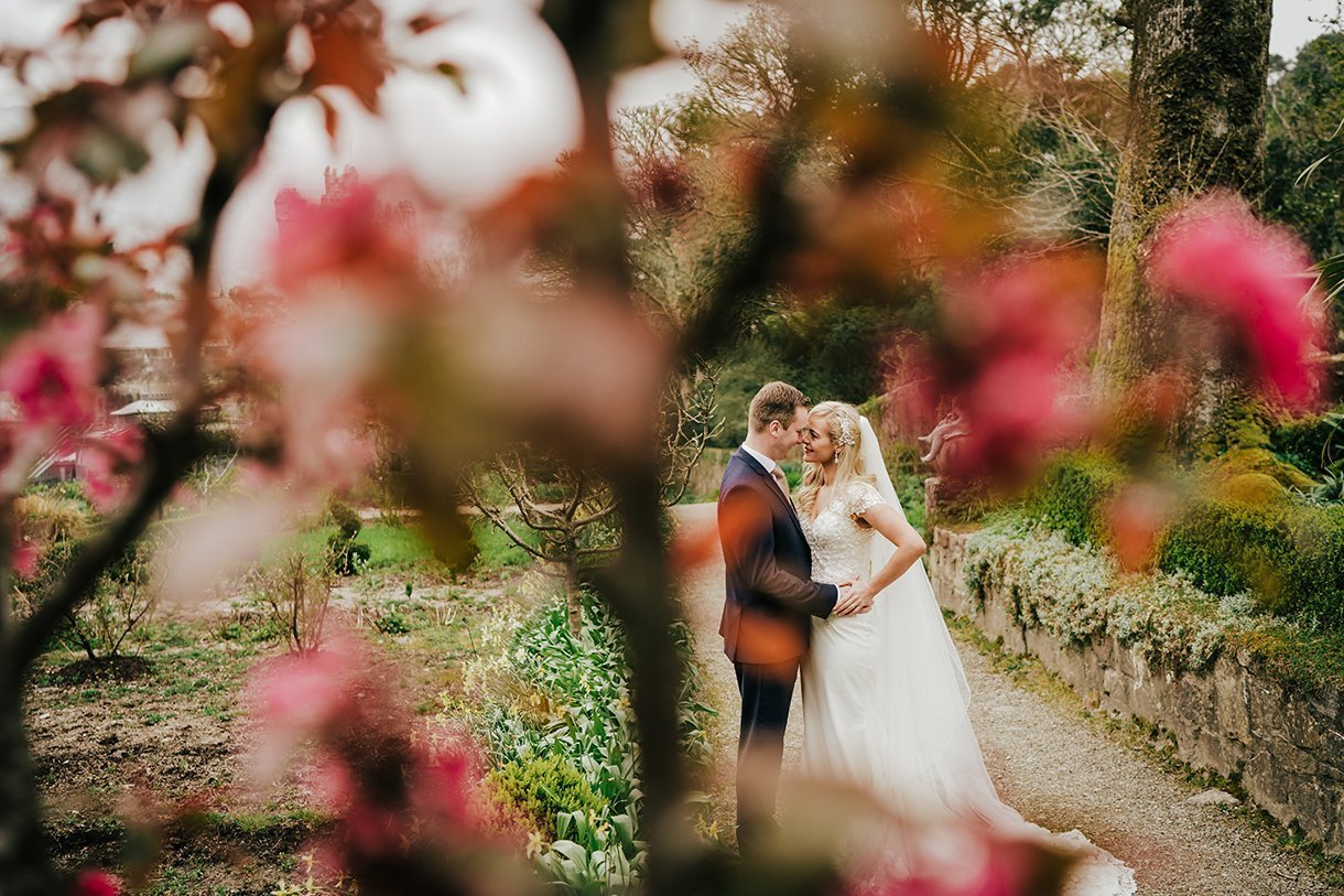 Glenveagh National Park Wedding bride and groom photo through a cherry blossom tree