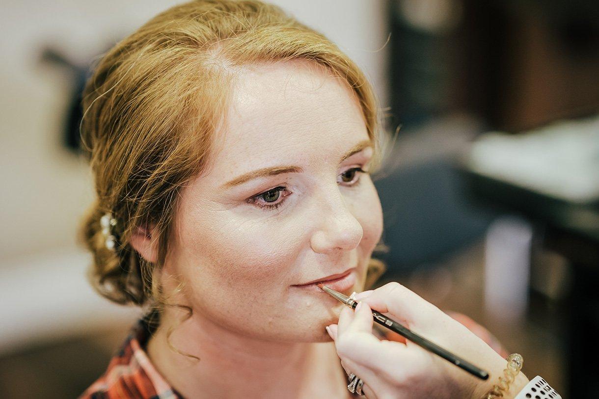 An Chuirt Hotel Weddings bride getting her makeup done