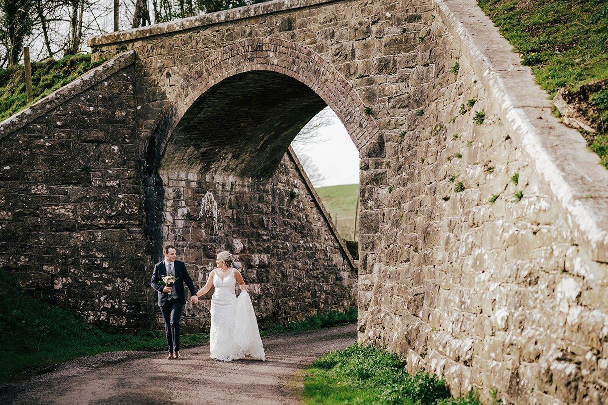 Sandhouse Hotel Rossnowlagh Wedding bride and groom walk under a railway bridge
