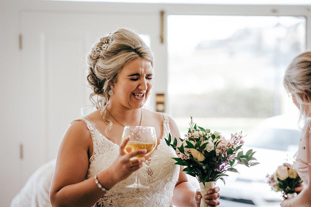 Sandhouse Hotel Rossnowlagh Wedding bride drinks stiff vodka
