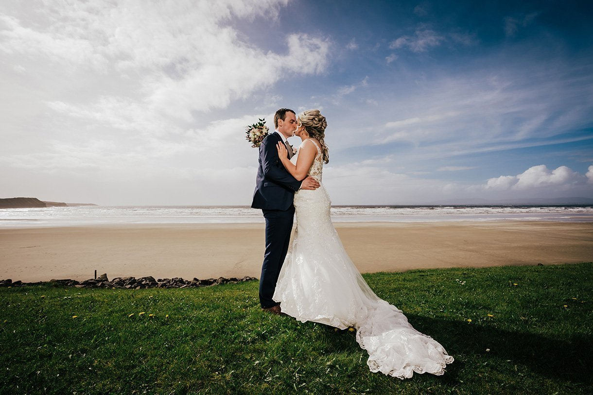 Sandhouse Hotel Rossnowlagh Wedding bride and groom kiss on the beach