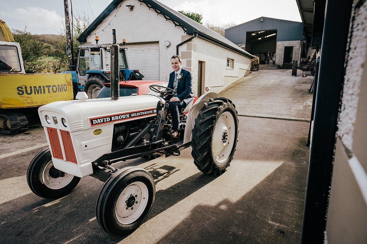 Sandhouse Hotel Rossnowlagh Wedding groom on a tractor