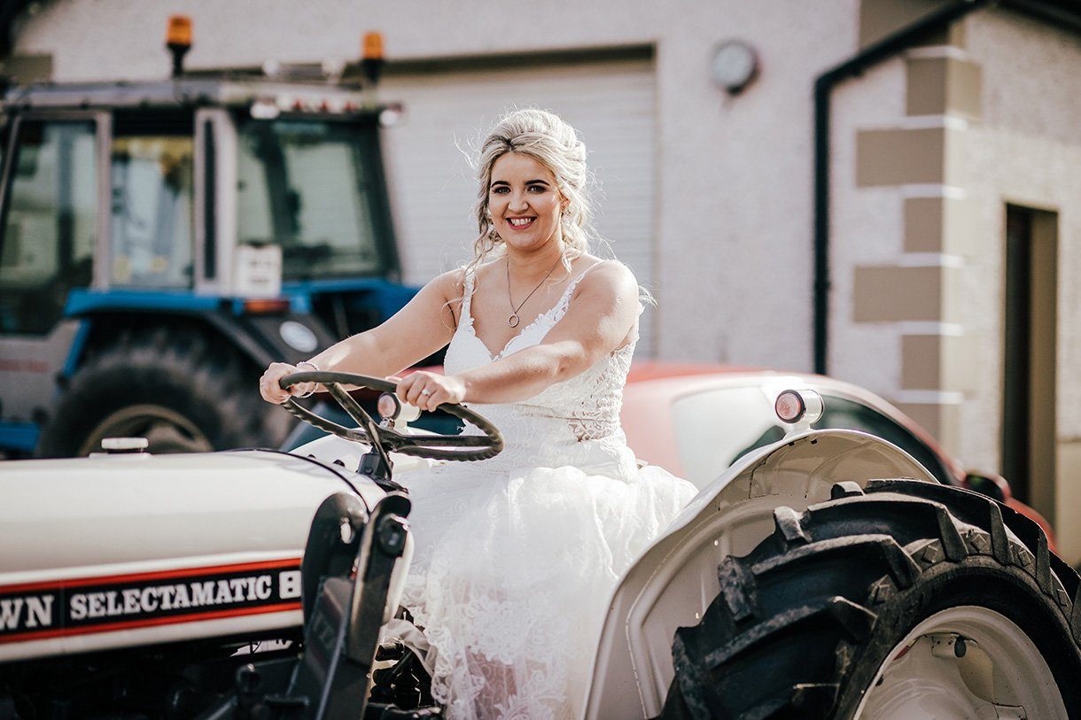 Sandhouse Hotel Rossnowlagh Wedding bride on a tractor